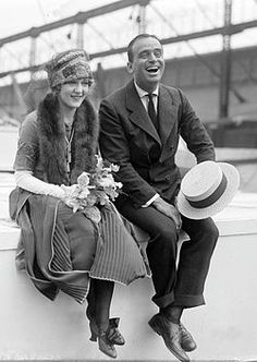1920s in Western fashion - a couple with design of that period