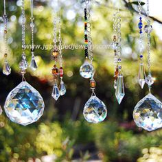 Decorate any window with a beautiful crystal sun catcher . JG Beaded Jewelry offers unique hanging prism crystals in many shapes and sizes. Feng Shui, Mobiles, Hanging Crystals, Yard Art, Suncatchers, Wind Chimes, Swarovski Crystals, Crystal Beads, Glass Art