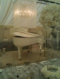 Elegant wedding styling, white piano, white hydrangeas, silver regency stripe linen, clear glass column vases, crystals