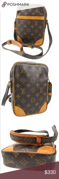 "Authentic Louis Vuitton Danube PM Crossbody The Louis Vuitton Monogram Canvas Danube Bag is perfect for daytime style. The Danube's squared shape is reminiscent of classic camera bags. Scaled for cell phone, wallet, and smaller essentials, with a convenient small inside pocket, an open outside pocket, and zip closure, this bag is great for sightseeing or if you're feeling like traveling light for the day. 6""by 8"". Peeled slide front pocket. Aging, stains on straps and leather. Louis Vuitton…"