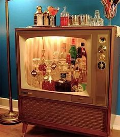 Old floor model television used for liquor storage.