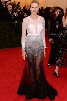 From afar, Naomi Watts looked like a beautiful swan in her Givenchy haute couture gown, but the feather-looking details were actually layers of paillettes arranged in an ombré pattern. Alone, the dress is a real work of art, but on a beauty like Watts, we can hardly look away.