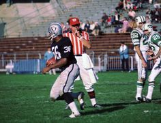 Clem Daniels totes the rock for the Oakland Raiders against the New York Jets. Beautiful AFL action shot.