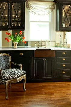 Love the black cabinets and copper sink.