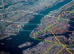 nyc-subway-system-map-overlaid-over-manhattan-aerial-image-2.jpg