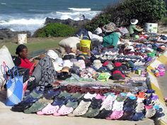 Street vendors selling their African beads on the beach of Port Edward in Kwa Zulu, Natal