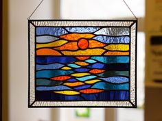 Sunset is an amazing natural phenomenon, and surely everyone loves to watch the sun disappear over the horizon. This is the most romantic time of the day. And I want to soak up and remember the last rays of the sun and stunningly beautiful glare on the water for a long time. This stained glass Hanging Stained Glass, Custom Stained Glass, Stained Glass Birds, Stained Glass Crafts, Stained Glass Patterns, Stained Glass Windows, Landscape Glass, Seascape Art, Window Hanging