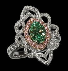 Elizabeth Taylor Ring with pink diamonds around a rare green diamond.