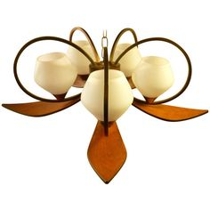 Wonderful Mid-Century Walnut Chandelier | From a unique collection of antique and modern chandeliers and pendants  at https://www.1stdibs.com/furniture/lighting/chandeliers-pendant-lights/
