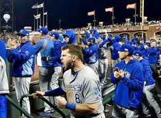 Kansas City Royals' Mike Moustakas (8) cheers with the team in the dugout after Alex Gordon hit an RBI double to score Alcides Escobar in the sixth inning during Friday's World Series baseball game against the San Francisco Giants on October 24, 2014 at AT&T Park in San Francisco, Cal.