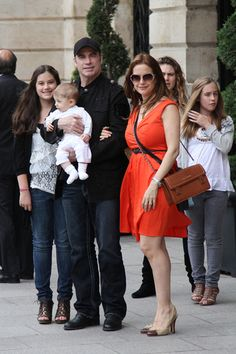 John Travolta snuggles with baby Benjamin in Paris