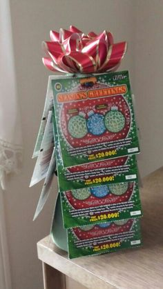 Lottery scratch-off tree. I think my grandpa liked it! Had issues getting the tickets to stick to the foam core. Christmas Neighbor, Christmas Makes, Christmas Holidays, Christmas Crafts, Christmas Ideas, Xmas, Bunco Gifts, Candy Gifts, Craft Gifts