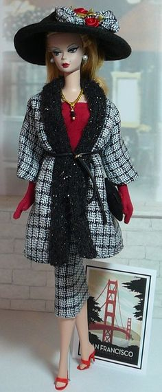 """""""Around the World - San Francisco"""" This 2-piece Travel Suit is designed to fit Silkstone Barbie or Model Muse Barbie Dolls. It is cut from black/white plaid suiting w/ red accents. Shoes are included w/ this ensemble."""