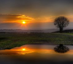 Sunset reflections (England) by Alan Sheers