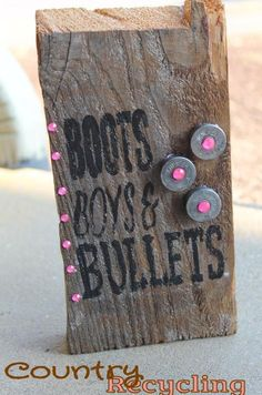 Boots boys and bullets sign with shogun shells https://www.etsy.com/listing/198667435/boots-boys-bullets-wooden-sign-with