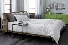 """light sleeper.  Woven cane headboard and whitewashed oak breathe light and nature into the bedroom.  Designed by Mermelada Estudio, this cozy bed """"achieves equilibrium by combining the solid language of a simple wood structure with the lightness of the perforated cane. """" Wrap-around headboard envelops an airy, sheltering profile of natural cane panels framed in an architectural oak grid.  Subtle whitewash finish reveals the beautiful sweeping grain and hi/lo tones of the wood."""