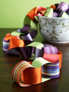 Give the elementary school paper chain craft a sophisticated update. Cut 1-1/2-inch-wide ribbon into 6-inch lengths. Bring the ends of a strip together to form a circle and secure with double-sided tape. Insert a strip of coordinating ribbon through the first circle and tape the ends together. Continue with alternating colors of ribbon until the chain reaches a desired length.