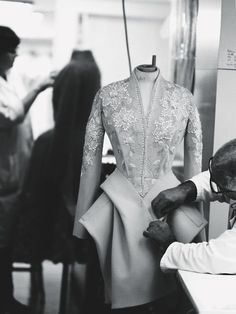 Dressmaking - inside the fashion atelier; sewing; the making of a haute couture dress // Christian Dior