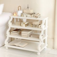 I don't like the style, really, but the stepped shelves would be perfect for all of the STUFF I keep on my bedside table.