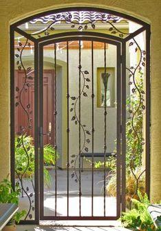 While the # wooden doors are also magnificent, what …- Si bien las Entry Doors, Entrance, Tor Design, Burglar Bars, Window Bars, Window Grill Design, Door Gate Design, Wrought Iron Doors, Modern Door