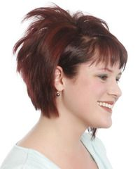 The back of this cool 'do is tapered into the head, blending into the jagged cut layers through the sides and top. The roots are teased at the crown to achieve height and lift, making it the perfect style to balance out a round face. The jagged cut bangs frame the top of the face perfectly and complete the over-all style beautifully.