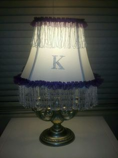 Kendyl's new lamp. Found lamp at goodwill and made the lampshade myself.