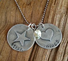 hand soldered, hand stamped soldered pendants. heart and star circle tags. my favorite right now. on sale.