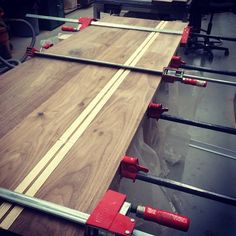 """""""Two part glue-up on a new solid walnut and ash dining table. #vancouver #furniture #design #canada"""""""