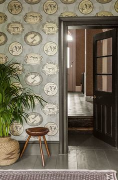 This is one of Cole & Son's more classical designs.  The Matrinah Wallpaper forms part of the charming and stylish new Ardmore collection and features an arrangement of ornamental platters and dishes