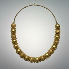 Etruscan (strung into a necklace in modern times), 6th century BCE, Plain and granulated beads, gold