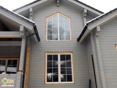 Дубовые #деревянные #окна с декоративными #раскладками в коттедже.  Трапециевидное #окно - второй свет.