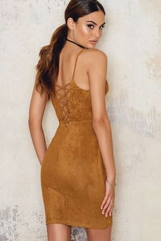 We absolutely adore this beautiful suede dress! The Suede Criss Cross Back dress comes in brown and features lace-up design at back, hidden zipper on the side, thin shoulder straps and a mini length. Rock this dress with a pair of boots and a hat!