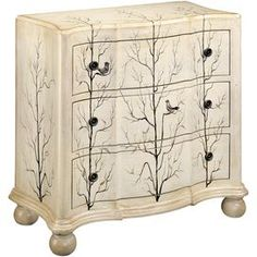 Wood chest with a tree motif.       Product: Chest    Construction Material: Wood     Color: Beige  Features:   Wooden knobs  Bun feet  Gently curved shapeThree drawers  Dimensions: 35 H x 38 W x 18 D