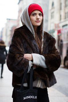 red beenie, hoodie, and fur (hopefully faux)