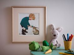 Benjamin Bunny from greypeg. Here is a young child, with a gorgeous tumble of curls, feeding his pet rabbit. Originally an illustration by Muriel Dawson.