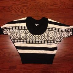 Delias bat sleeve sweater Black and white. No flaws. Smoke free home. Comes short right to top of jeans. Large sleeves at armpit but tighter as they go towards wrist. Sweaters Crew & Scoop Necks