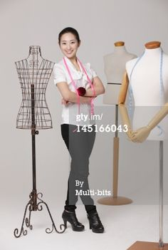 Stock Photo : Fashion designer with tape measure
