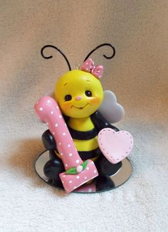 I handcrafted this little polymer clay bee holding the number 1 without the use ...