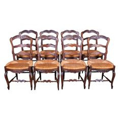 Set of 8 Louis XV style dining chairs from Provence with intricate carving in the tradition of the region. Hand crafted from solid walnut, this charming set dates from the 1850s and is one of the prettiest sets we've had. Each chair is decora