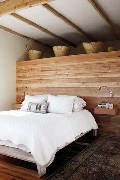 serene bedroom // wood panel walls // exposed wood beams // built in nightstands // white bedding
