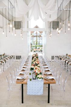 Love the long tables, lights + chairs. Photography: Angga Permana