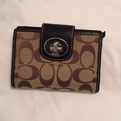 Coach wallet Multiple credit card slots, spacey area for cash, and a zippered coin section! Coach Bags Wallets