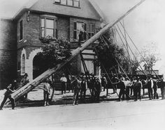 Erecting a telephone pole at King and Dufferin, Toronto, Canada 1895.