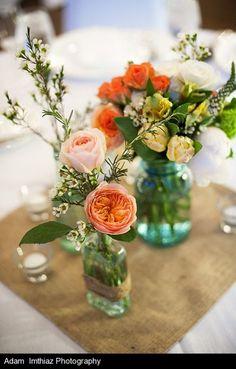 Juliet garden roses, coral ranunculus, yellow parrot tulips, spray roses, veronica, viburnum, waxflower