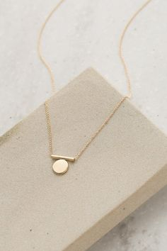 """Delicate gold necklace with light chain and gold circle accent at center of chain. Chain is 9.5"""" at longest adjustment. 40393N-1"""