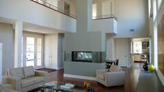 Hower Architects| Modern fireplace + wood floors http://www.greenmtwood.com/pin.html