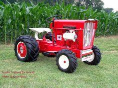 Cub Cadet in red attire Tractor Mower, Red Tractor, Lawn Tractors, Lawn Mower, Tractor Farming, Antique Tractors, Vintage Tractors, Garden Toys, Lawn And Garden
