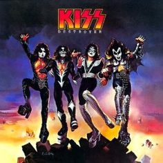 Top 50 Most Iconic Album Covers - IGN - KISS/Destroyer - The original art, fantasy artist, Ken Kelly submitted for this album was rejected by the record label for appearing too violent. This toned down version still finds the band atop a pile of rubble with the glow of flames in the background.