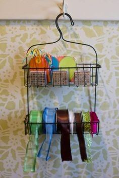 The ends of decorative ribbon stick out between the wires on the bottom shelf of this shower caddy, while gift-wrapping accessories like name tags and stamps sit on the top shelf. The only thing that's missing is the paper! See more at Sonoma Decorative Arts »