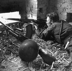 British sniper Jack Bailey in Italy. I like that he is sniping with a scoped M1917 Enfield, but has a Bren machine gun for more indiscriminate combat.